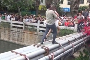 남편 외도 의심해 강에 투신 시도한 아내