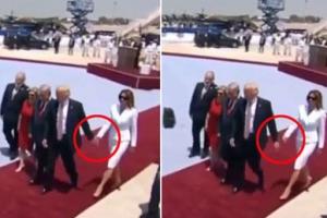 트럼프 대통령 손 뿌리치는 멜라니아 여사 포착