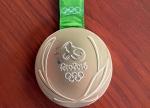 올림픽 금메달도 변색되네…