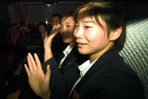 [서울포토] 인사하는 미모의 북한 여성 태권도시범단