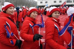 [서울포토] 경기 연기로 퇴장하는 북한 응원단