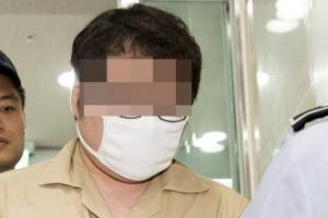 [포토] '드루킹 공범' 둘리 우모씨, 특검 사무실 출석