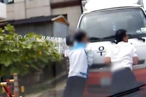 경사로 미끄러지는 트럭 온몸으로 막은 경찰