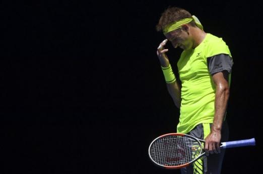 테니스 샌드그렌이 24일 호주 멜버른에서 열린 2018 호주오픈 테니스대회 남자단식 8강전에서 정현에게 포인트를 빼앗긴 뒤 얼굴을 찡그리고 있다. AP 연합뉴스