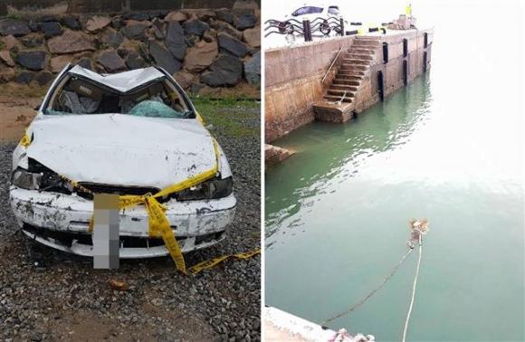 태안서 승용차 바다로 추락해 1명 사망 지난 16일 오후 충남 태안군 안면읍 영목항 여객터미널 주차장에서 승용차 1대가 해상으로 추락했다. 이 사고로 운전자 A(70)씨는 탈출했으나 동승자 B(62)씨는 숨졌다. 사진은 견인된 차량(왼쪽)과 견인되는 모습.(태안해경 제공) 뉴스1