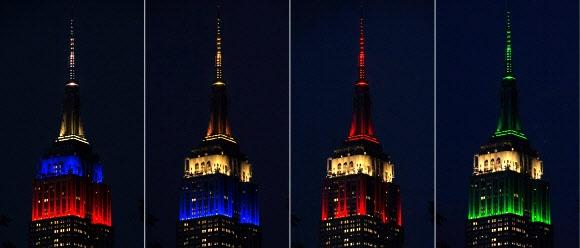뉴욕 마천루 밝힌 월드컵 참가국 국기 조명 13일(현지시간) 미국 뉴욕 엠파이어 스테이트 빌딩 꼭대기에 발광다이오드(LED) 조명으로 재현된 2018 러시아월드컵 참가국들의 국기가 장관을 이루고 있다. 러시아, 우루과이, 이집트, 사우디아라비아의 국기를 형상화한 조명이 환하게 빛을 발산하는 모습.  뉴욕 AFP 연합뉴스