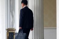 [포토] 北 김창선, 정장차림에 서류가방 들고 어디로?
