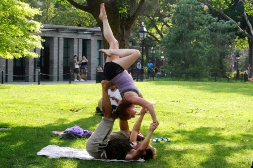 People workout in Washington Square Park during hot weather in the Manhattan borough of New York, New York